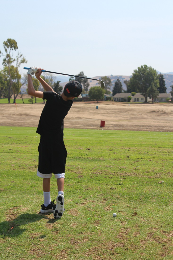 Cade Garrett goes out with his father to the Ridgemark driving range. Photo by Julia Hicks.
