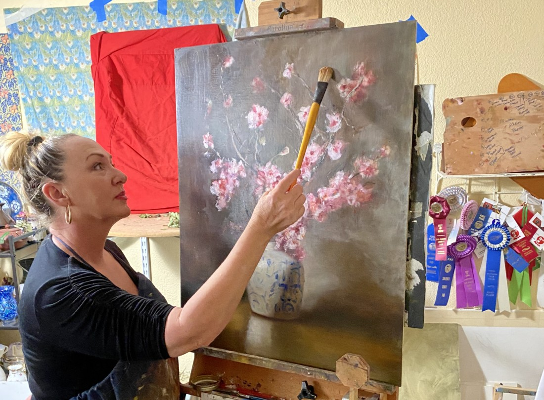 Julianna O'Hara paints in the studio with oils. Photo courtesy of Julianna O'Hara.