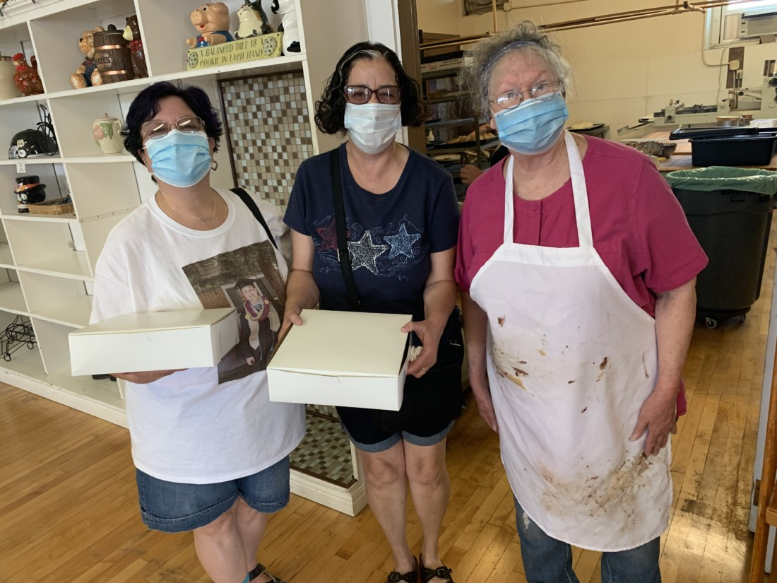 Ginger Russo, Mary Regalo, and bakery owner Dianne Hampton. Photo by Robert Eliason.