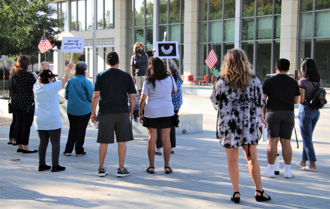 Residents held a Sept. 19 vigil for late Supreme Court Justice Ruth Bader Ginsberg in front of the court house on Fourth Street in Hollister. Photo by John Chadwell.