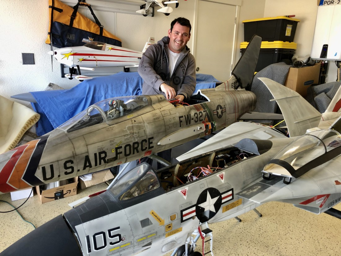 Andre Torres working on two jets in his garage. Photo by John Chadwell.