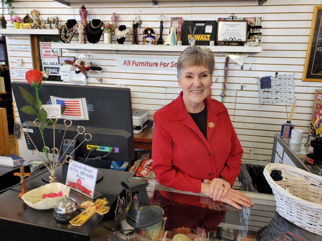 Linda Lampe at the counter of Worth Saving Mercantile and Thrift Store. Photo courtesy of Linda Lampe.
