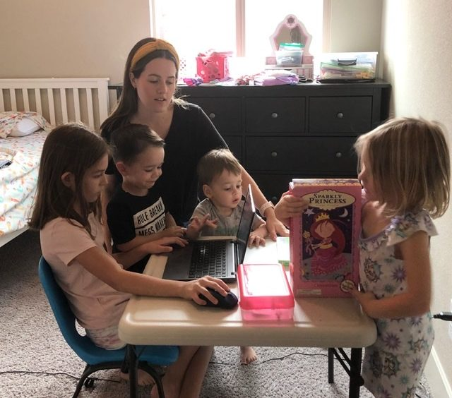 Ashley Neuman helps daughter Addyson, a second grader at Cerra Vista, with distance learning while her other children look on. Photo courtesy of Ashley Neuman.