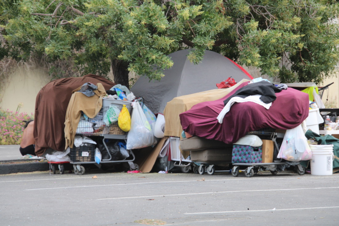 A homeless encampment moved from Dunne Park to the empty lot on Fourth Street in Hollister next to Briggs building. Photo by John Chadwell.