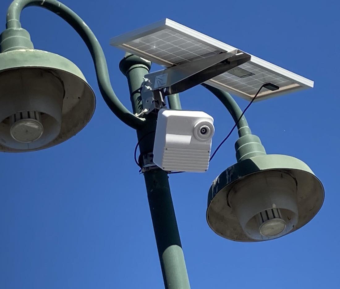 Solar cameras provide surveillance for local ballot drop boxes. Photo by Noe Magaña.