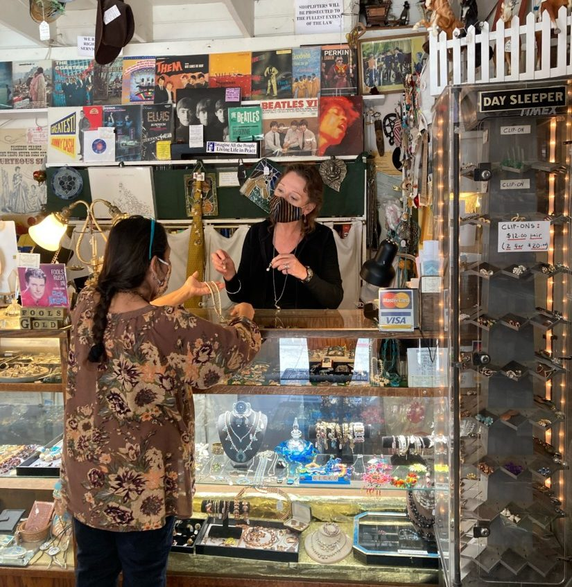 Halina Kleinsmith of Fool's Gold in San Juan Bautista helps a customer. Photo by Rochelle Eagen and courtesy of Halina Kleinsmith.