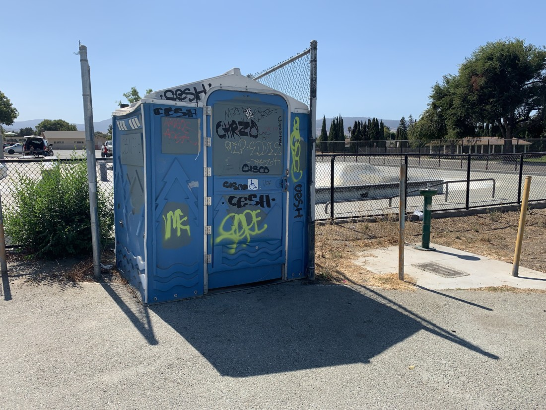 Graffiti on a portable bathroom at the park. Photo by Robert Eliason.