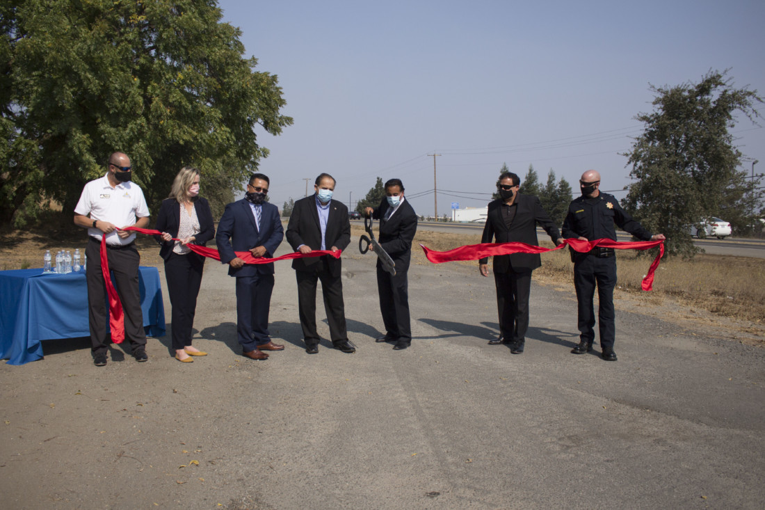 Hollister City Manager Brett Miller, COG Executive Director Mary Gilbert, Supervisor Peter Hernandez, Supervisor Jaime De La Cruz, Hollister Mayor Ignacio Velazquez, County Administrative Officer Ray Espinosa and Capt. Chris Armstrong at an Oct. 7 ribbon-cutting ceremony for the Highway 25 expansion project. Photo by Noe Magaña.