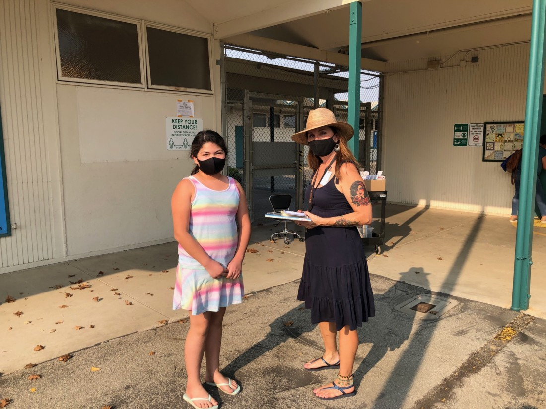 Fifth grade Sunnyslope student picking up library books from Aguilar. Photo provided by Joseph Rivas Jr.