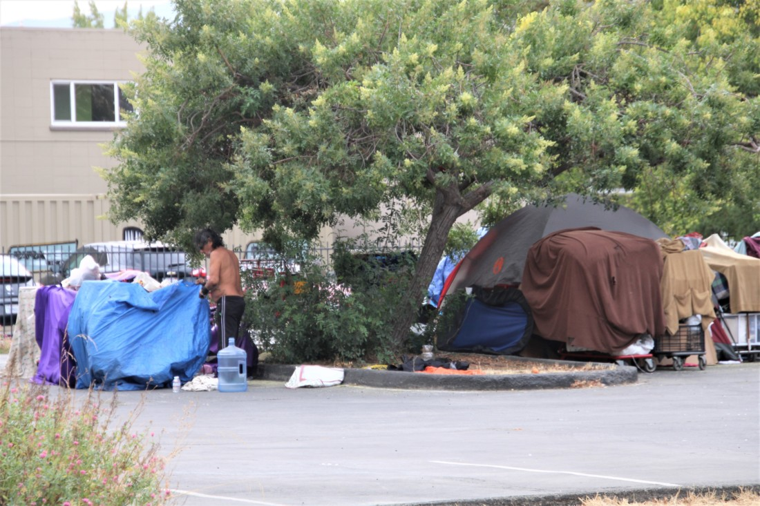 Homeless camp on Fourth Street. Photo by John Chadwell.