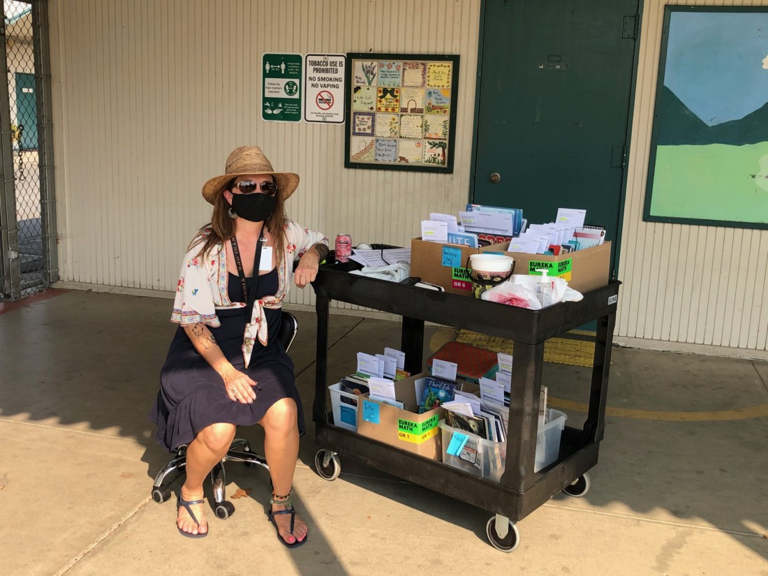 Sunnyslope Elementary School's Library Media Specialist Stephanie Aguilar distributing books. Photo provided by Joseph Rivas Jr.