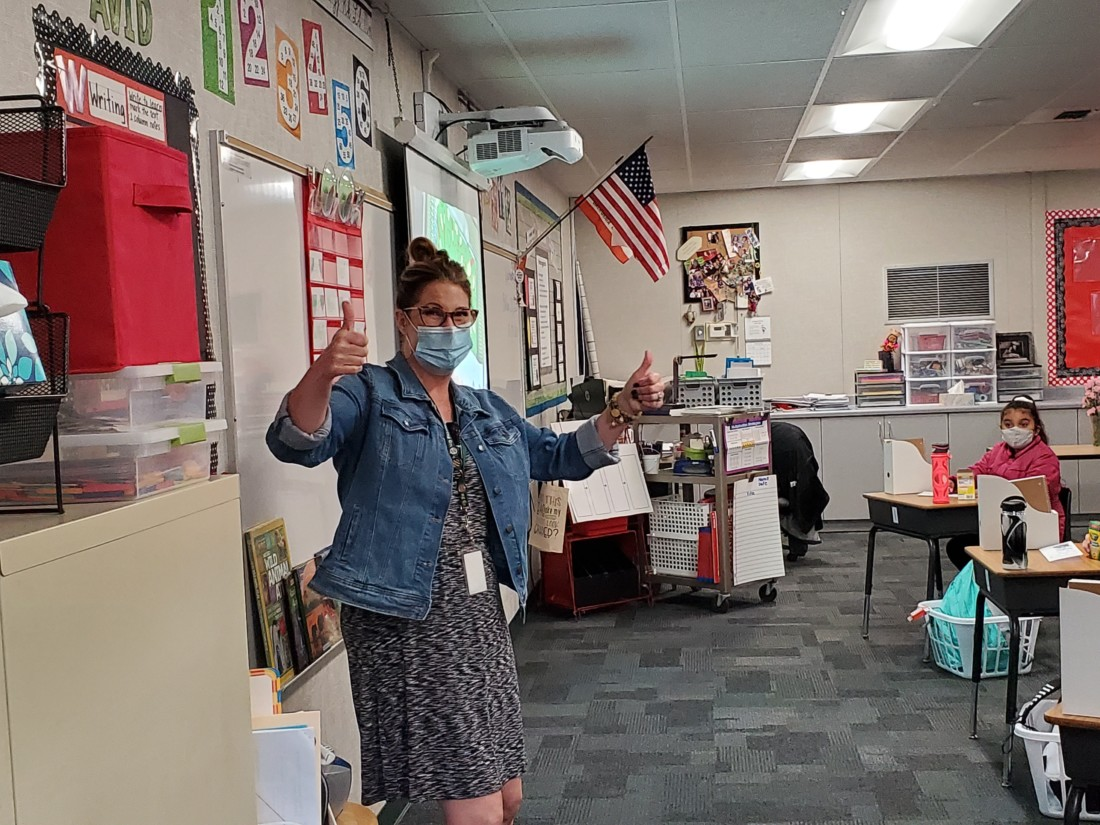 Third grade teacher Gina Tomasini gives two thumbs up excited to be back teaching her students in the classroom. Photo courtesy of Spring Grove.