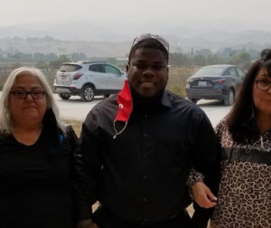 Former CYS Resident Andre (middle) with Lupe (left) and Rachel (right). Photo provided by Chamberlain's Youth Services.