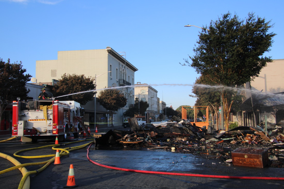 Firefighters battled two structure fires in downtown Hollister within minutes of each other in the early morning hours of Nov. 2. Photo by John Chadwell.