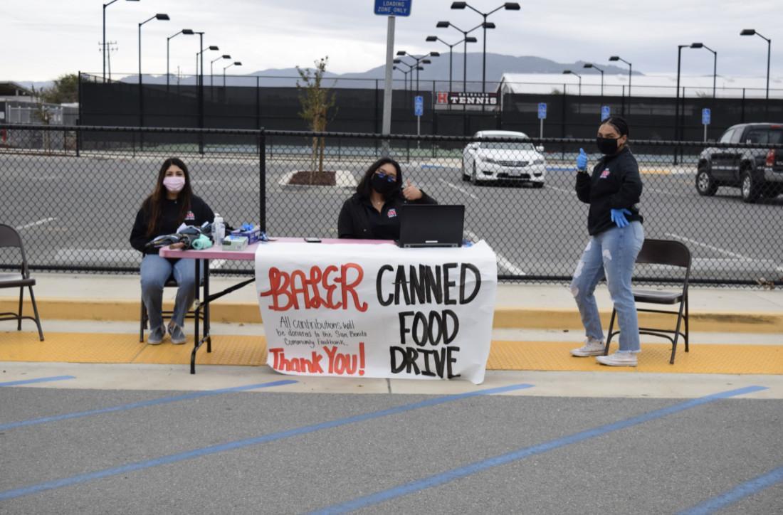 SBHS students Tina Javid, Mikhaila Tamondong and Denae Rivera work to collect nonperishable food items. Photo courtesy of Faith Fernandez.