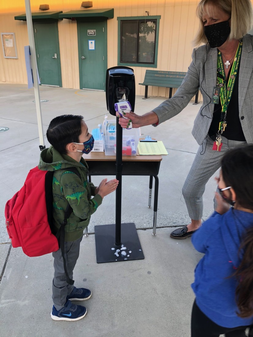 NCJUSD Superintendent and Spring Grove Principal Jenny Bernosky stands at one of three temperature check stations. Photo courtesy of Spring Grove.
