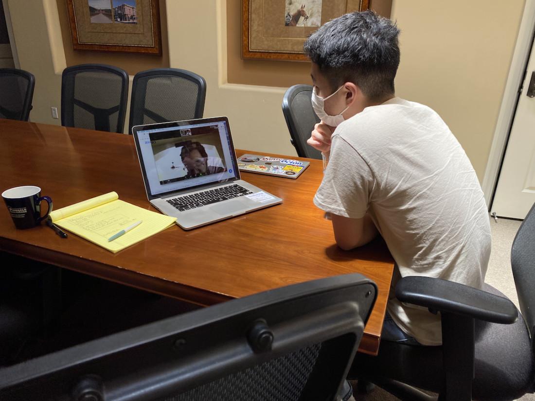 Francisco Romero (on screen) shares his knowledge with 2020 computer intern Kurt Higa. Photo by Leslie David