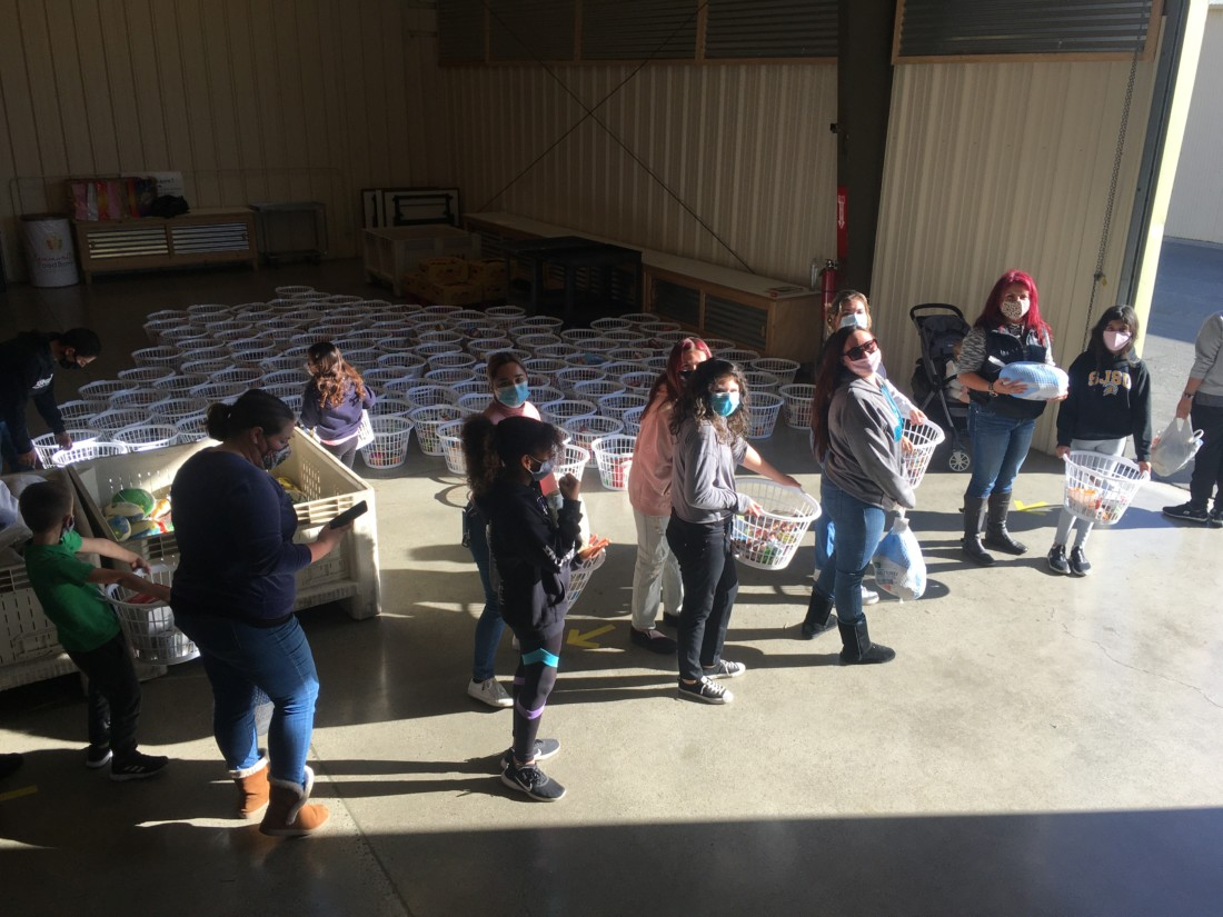 Volunteers ready to distribute the Thanksgiving baskets at Community FoodBank. Photo by Andrew Pearson.