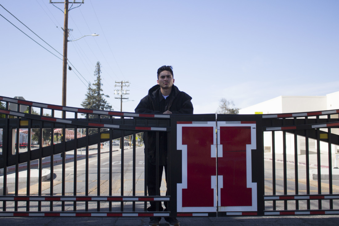 Daniel Leon behind the San Benito High School gate that closes part of Nash Road during school hours. Photo by Noe Magaña.