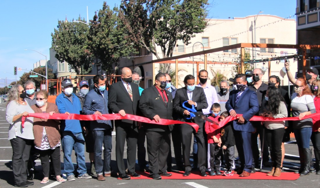 Hollister Mayor Ignacio Velazquez cuts the ribbon on Nov. 14 celebrating the reopening of San Benito Street after a beautification project. Photo by John Chadwell.