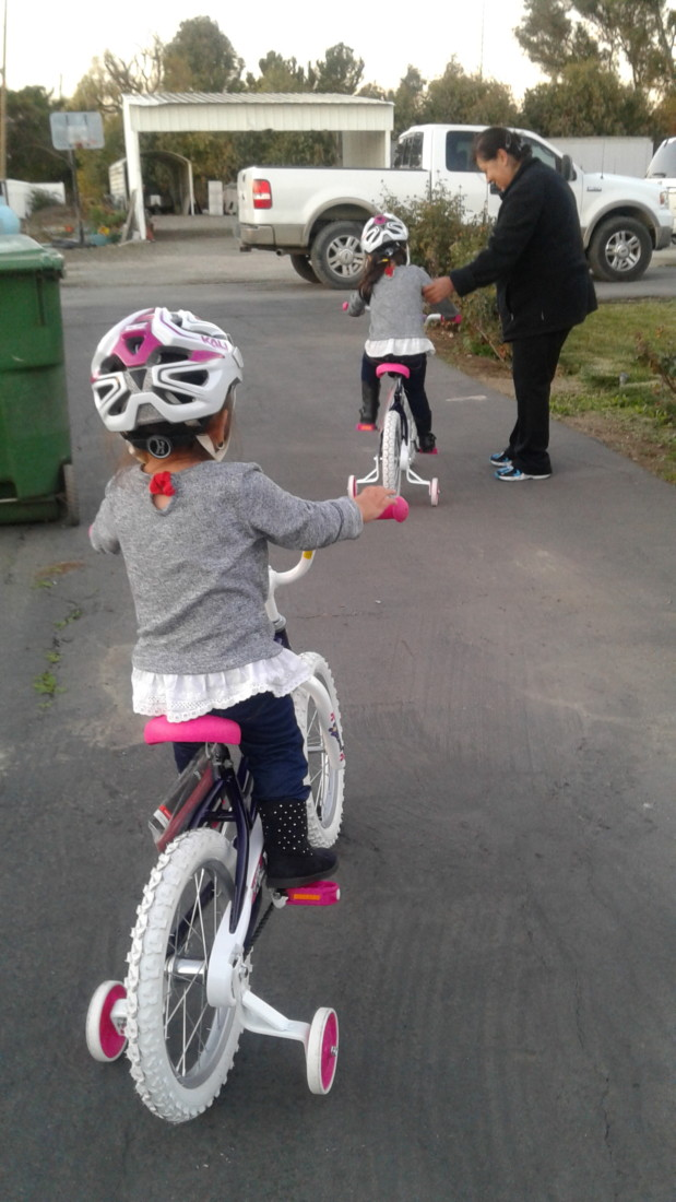 Sisters taking their new bikes for a spin at Christmas. Photo courtesy of CASA.