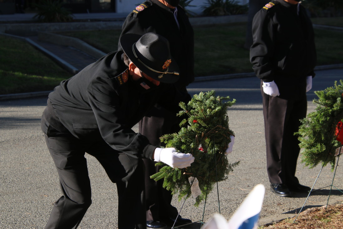 VFW Honor Guard member lays wreath during the 2020 Wreaths Across America ceremony. Photo by John Chadwell.