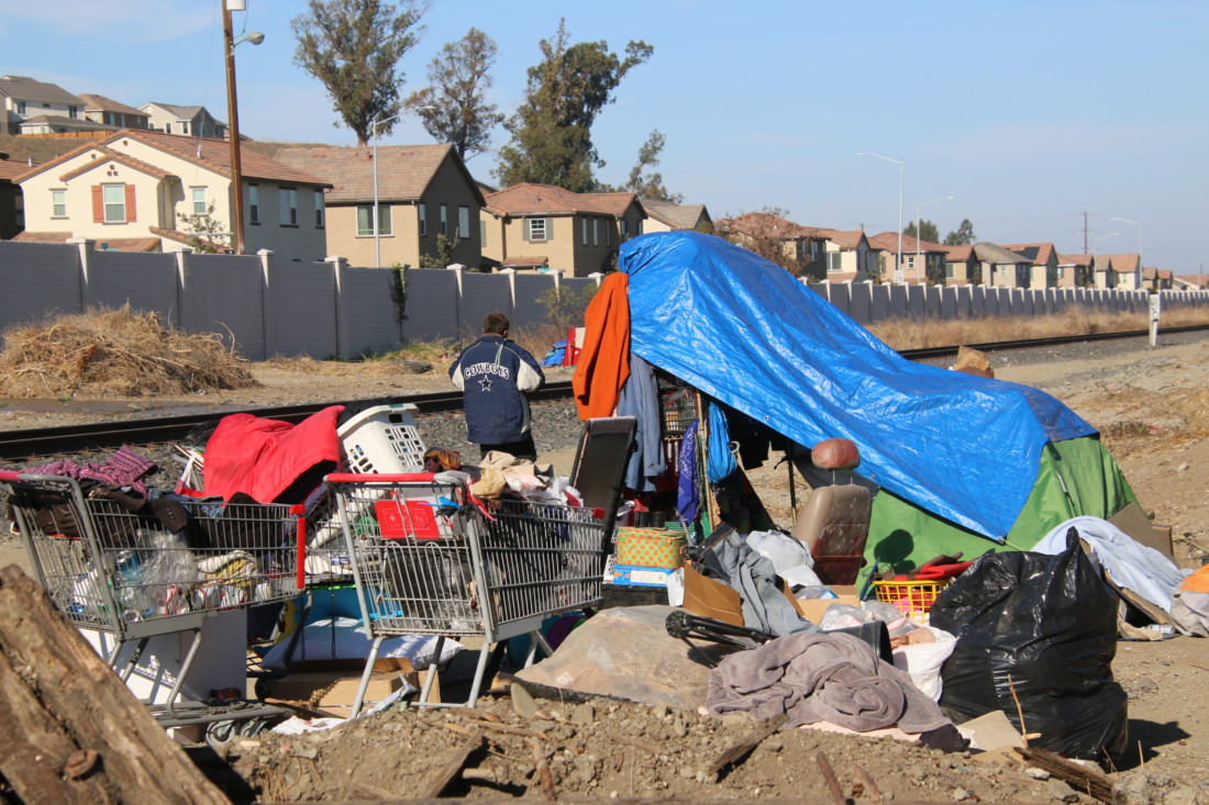 The homeless encampment is several separate campsites stretched along the railroad tracks. Photo by John Chadwell.