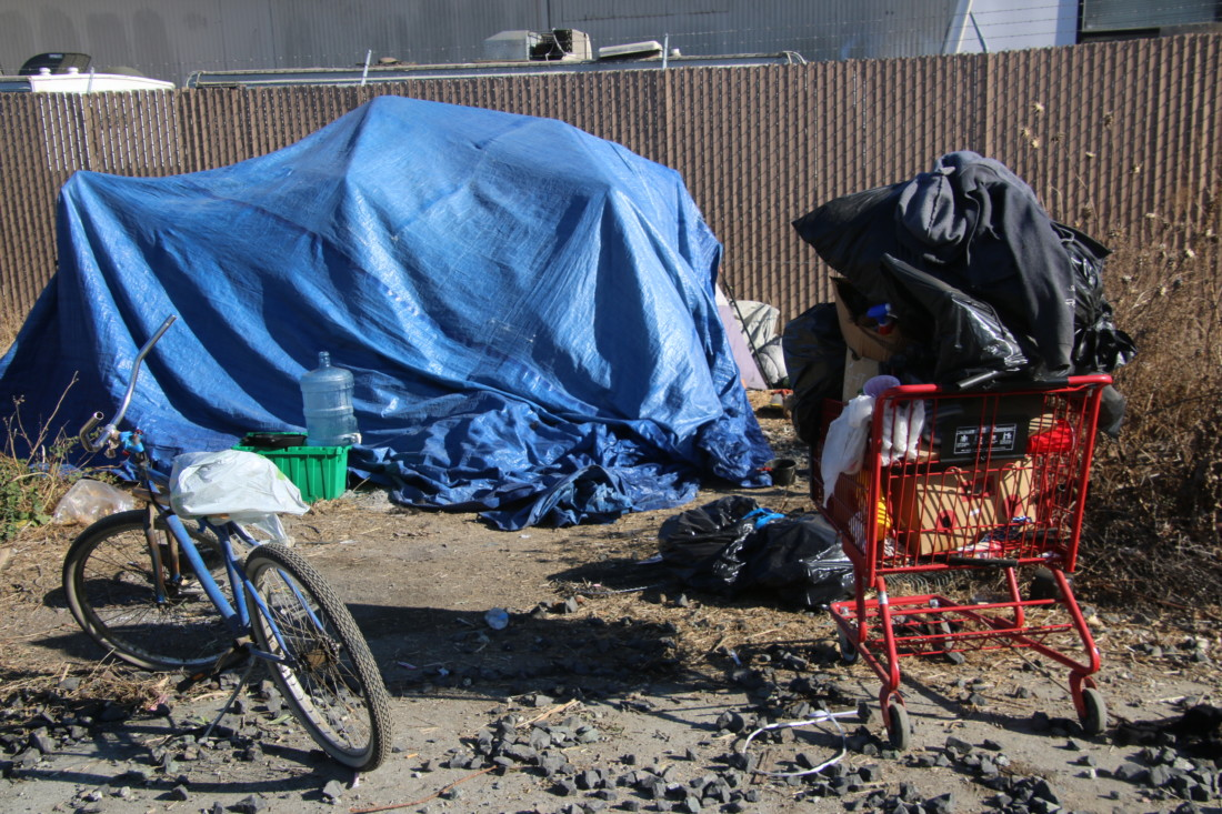 About a dozen or so homeless people now live and store their possessions near the tracks. Photo by John Chadwell.
