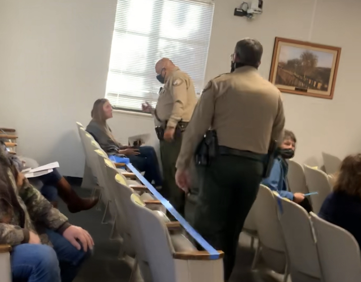 Courtney Evans and deputies with the San Benito County Sheriff's Office at a Dec. 15 Board of Supervisors meeting. Image from video taken by resident Elia Salinas.