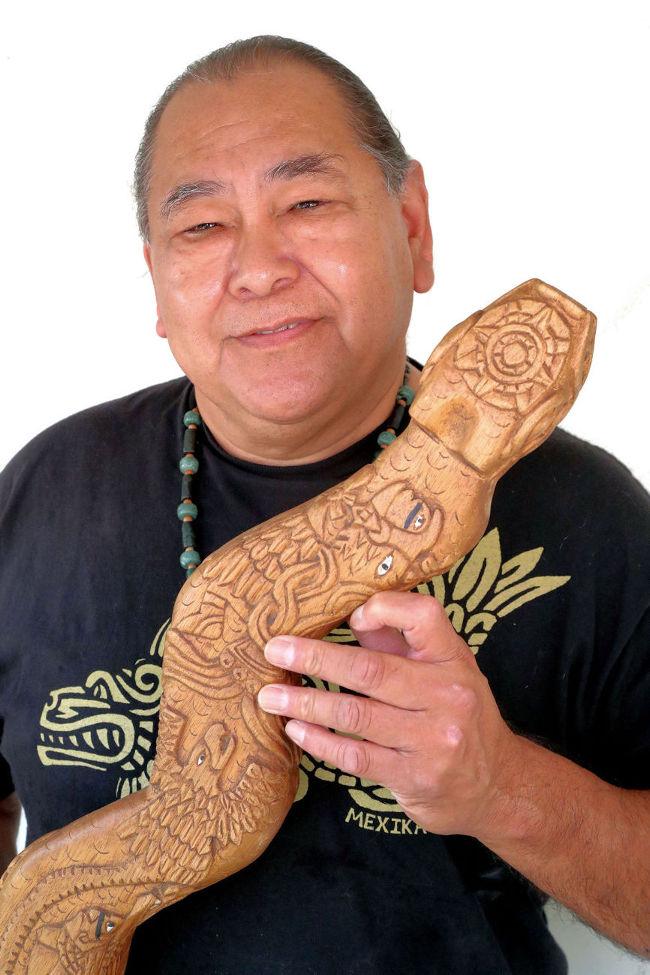 Noe Montoya with indigenous wind instrument. Photo by Robert Eliason