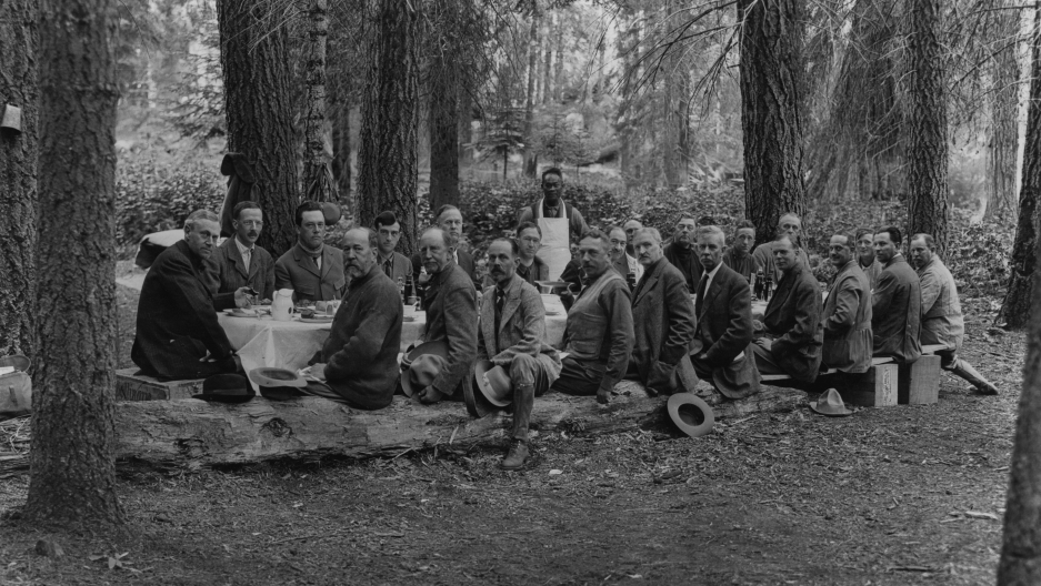 The Mather Mountain Party enjoys a meal prepared by Tie Sing. Photo courtesy of Dr. Gilbert H. Grosvenor, National Geographic Creative and provided by Sharlene Van Rooy.