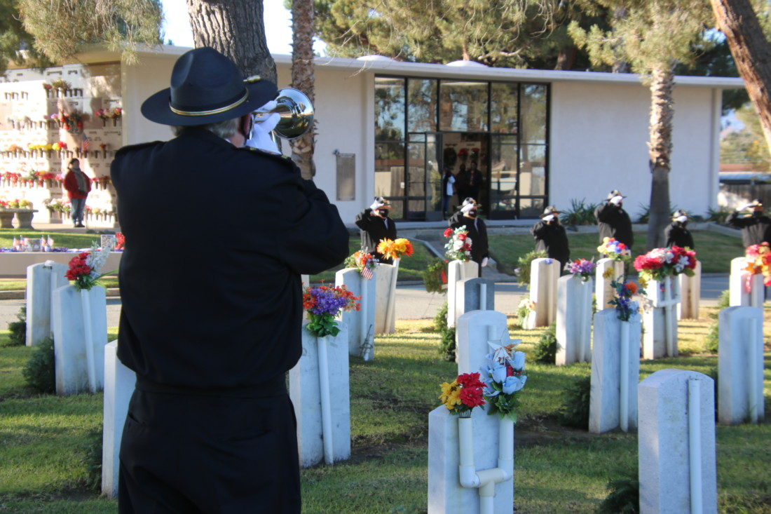 The sound of Taps echoed across the cemetery. Photo by John Chadwell.