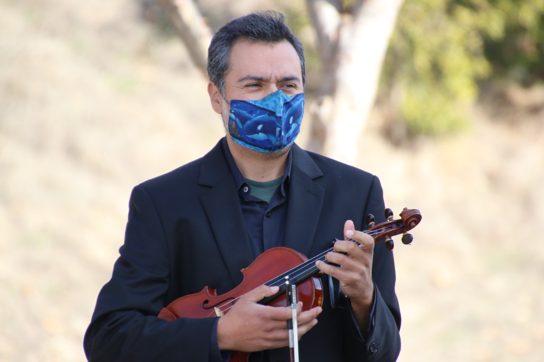 Adam Scow, a full-time environmental advocate who ran against Congressman Jimmy Panetta in the March primary election, came to support the protest with music. Photo by John Chadwell.