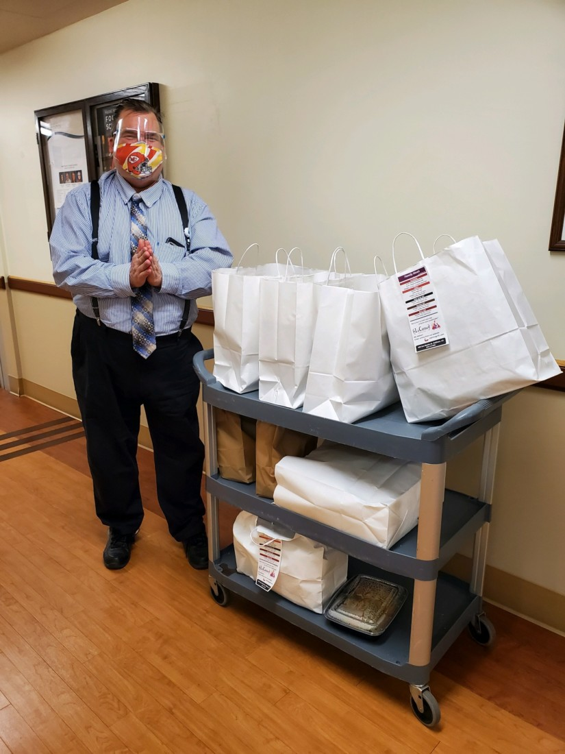 Dan Price, director of the ICU and Medical/Surgical floor, with donated meals. Photo courtesy of Frankie Gallagher.