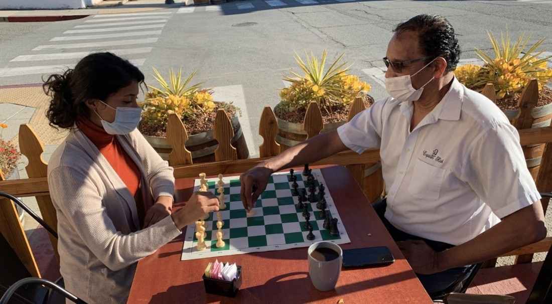 Ruby Hill and Ken Kirkland play chess in San Juan Bautista. Photo by Robert Eliason.
