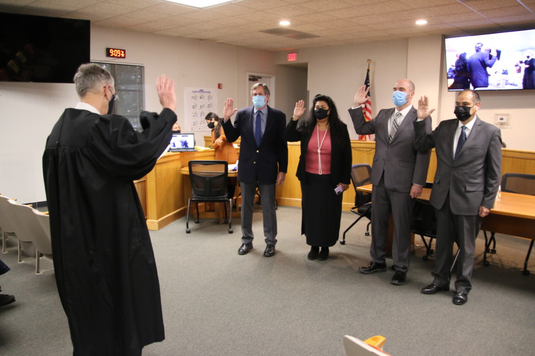 Retiring Superior Court Judge Steven Sanders swore in Bob Tiffany, Bea Gonzales, Kollin Kosmicki and Mark Medina on Jan. 4. Photo by John Chadwell.