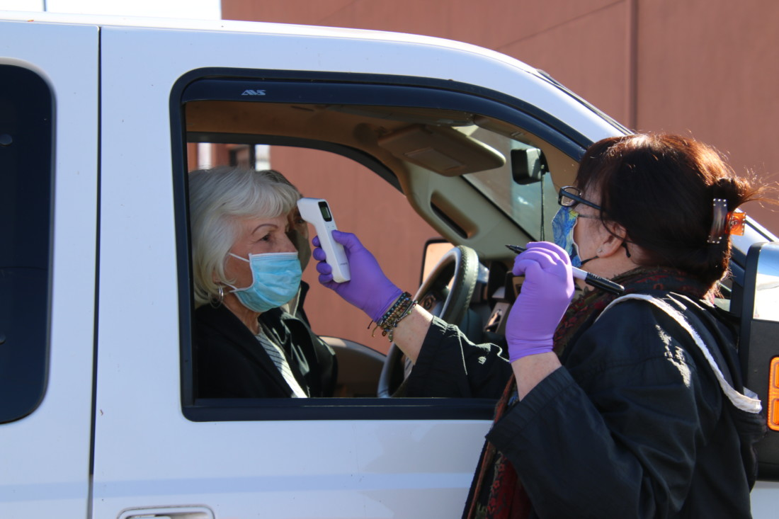Public health staff checked temperatures before vaccinating residents on Jan. 29. Photo by John Chadwell.