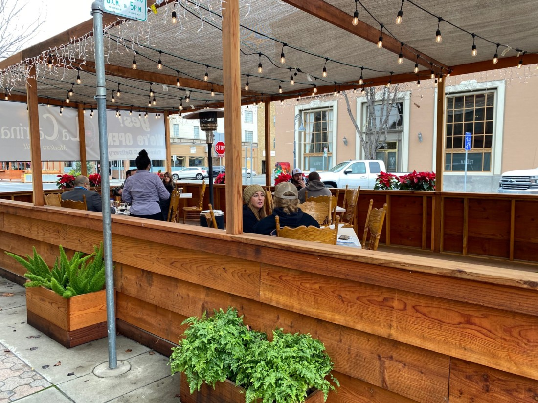Customers enjoying food in La Catrina's outdoor dining parklet. Photo by Leslie David.
