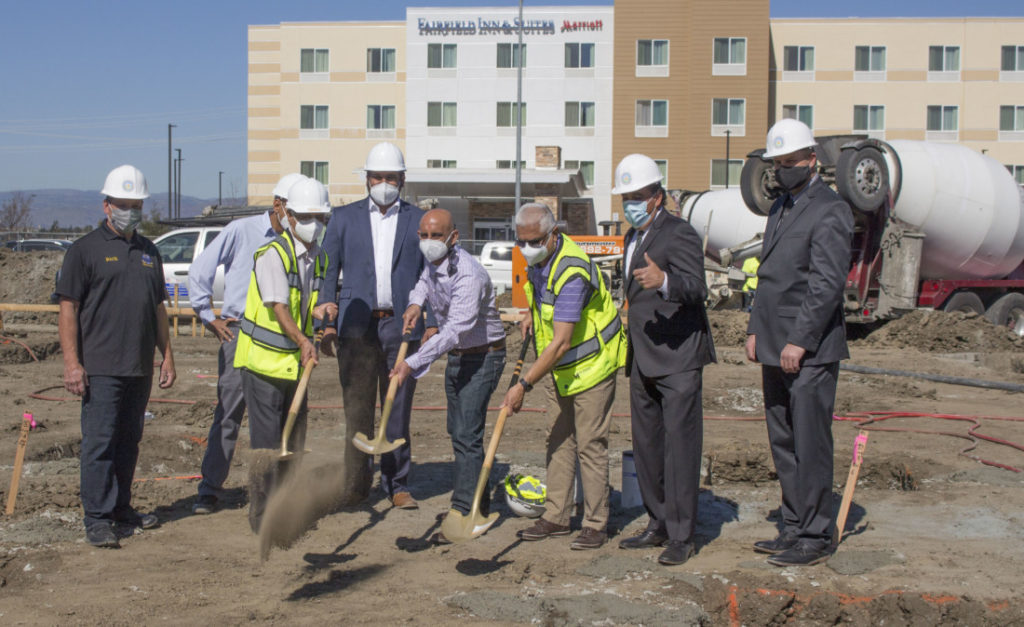 Representatives from Hollister and Lotus Management Inc. at the Feb. 24 groundbreaking for a new hotel on Gateway Drive. Photo by Noe Magaña.