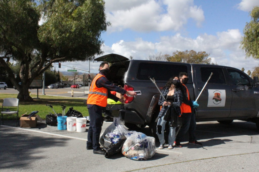 Rudy Picha, Jasmine Salazar and Victor Espinoza during the Hollister Litter Project street cleanup on March 20. Photo by Carmel de Bertaut.