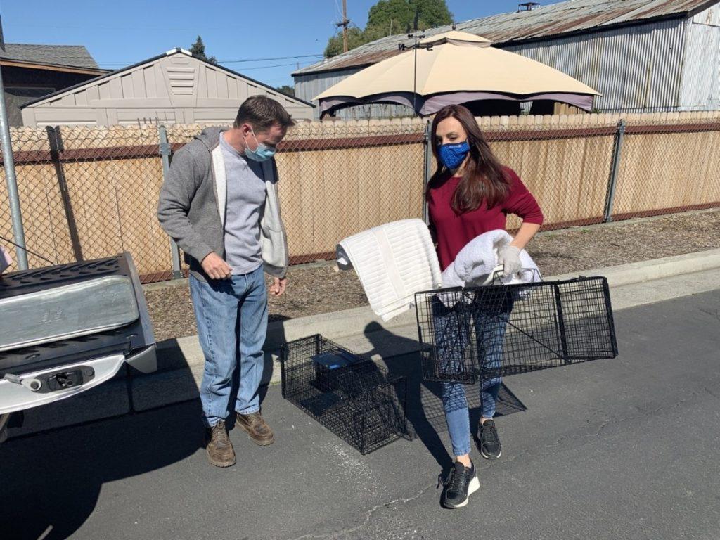 Eric and Marina Gordon with traps. Photo by Robert Eliason.