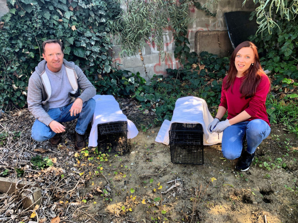 Eric and Marina Gordon with traps for feral cats. Photo by Robert Eliason.