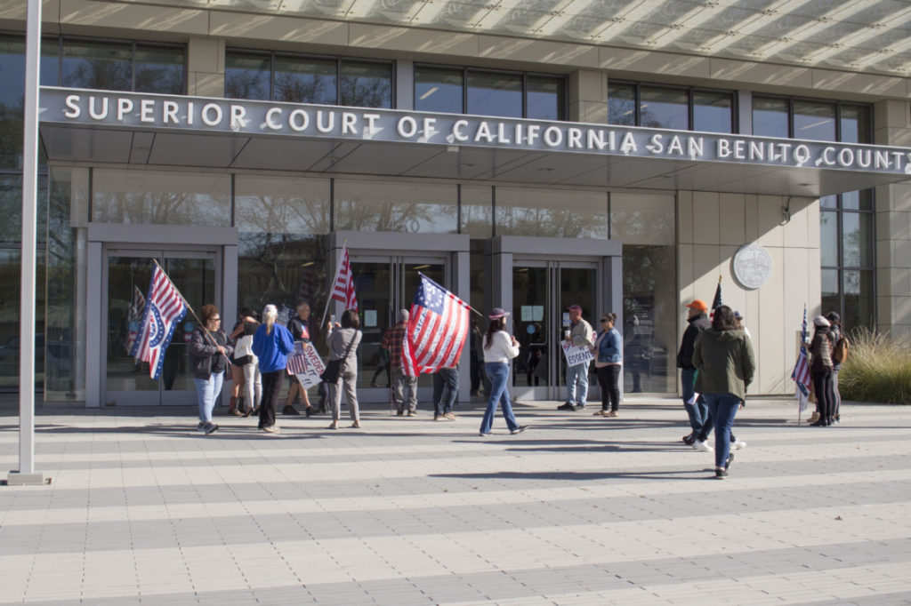 A group of about 15 people outside the courthouse on March 30 voicing their support of Courtney Evans. Photo by Noe Magaña.