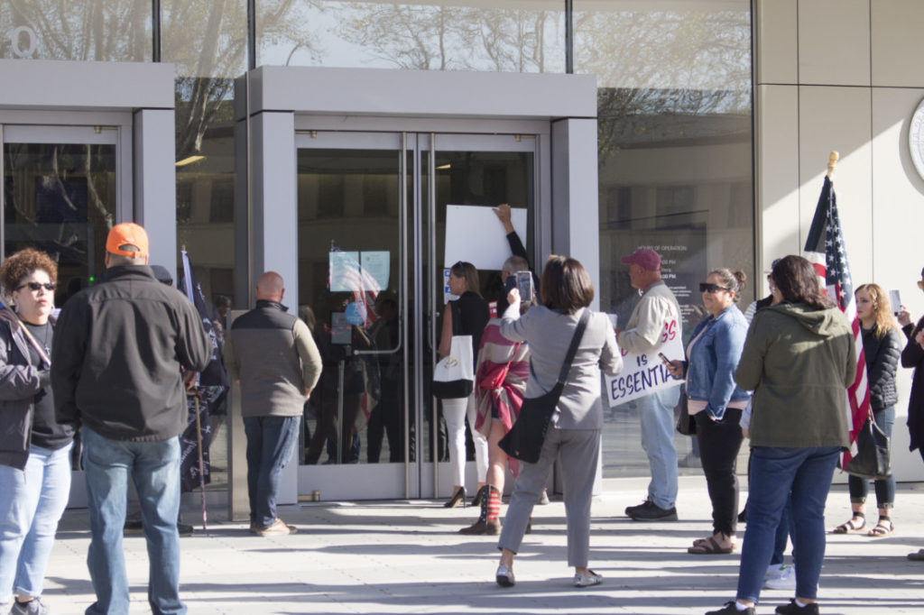 Courtney Evans (center) and her supporters outside San Benito County Superior Court on March 30, 2021. Photo by Noe Magaña.