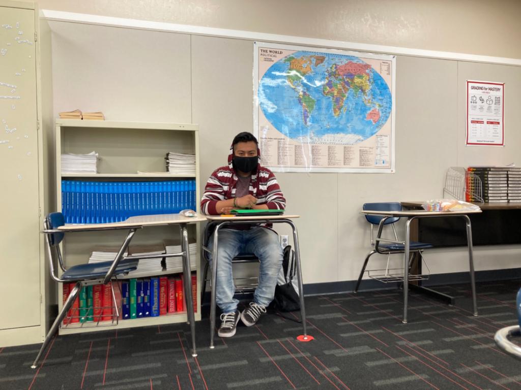 Christian de Jesus Cardenas doing his homework after school. Photo by Noe Magaña.