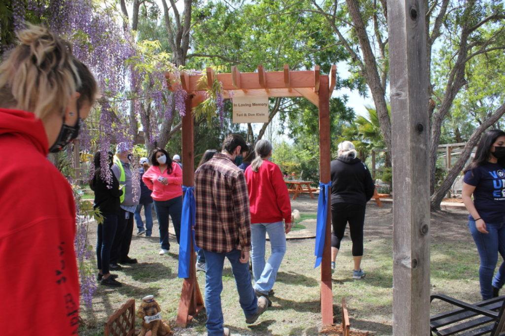 Staff walk through to the new park area. Photo by Carmel de Bertaut.