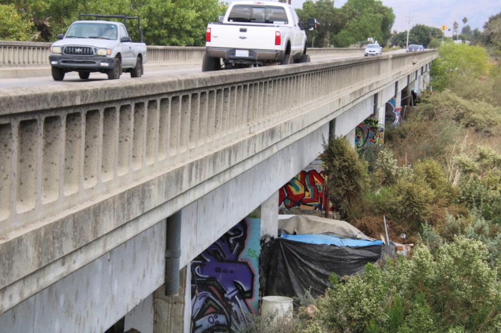 Homeless encampment below 4th Street bridge. Photo by John Chadwell.