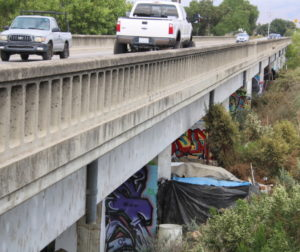 Homeless encampment below 4th Street bridge. Photo by John Chadwell.