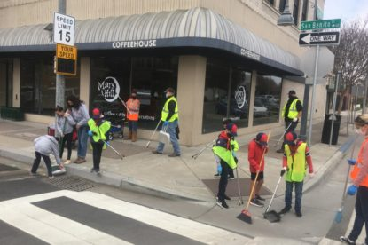 The Cub Scouts and adult Den Leaders of Pack 455 clean the corner of San Benito and Sixth Streets. Photo by Andrew Pearson.