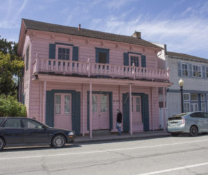 A person walks past Casa Rosa in Downtown San Juan Bautista on April 2, 2021. Photo by Noe Magaña.